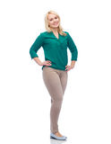 Smiling young woman in shirt and trousers Royalty Free Stock Photos