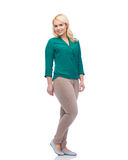 Smiling young woman in shirt and trousers Royalty Free Stock Images