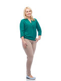 Smiling young woman in shirt and trousers Stock Images