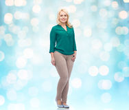 Smiling young woman in shirt and trousers Stock Photography