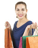 Smiling young woman with shopping bags Stock Images
