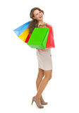 Smiling young woman with shopping bags Royalty Free Stock Photo