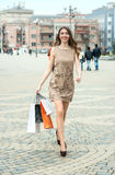 Smiling  young woman with shopping bags  in the city Royalty Free Stock Photography