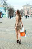 Smiling  young woman with shopping bags  in the city Royalty Free Stock Photo