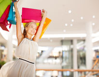 Smiling young woman with shopping bags Stock Photo