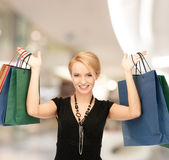 Smiling young woman with shopping bags Royalty Free Stock Photography