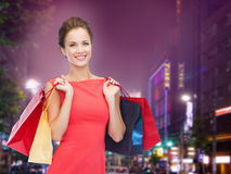 Smiling young woman with shopping bags Stock Photography