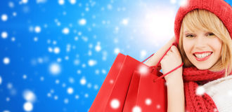 Smiling young woman with shopping bags Royalty Free Stock Photos