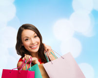 Smiling young woman with shopping bags Royalty Free Stock Images