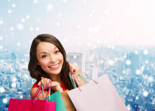Smiling young woman with shopping bags Stock Photos