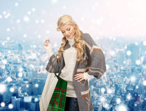 Smiling young woman with shopping bags Royalty Free Stock Image