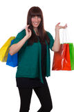 Smiling young woman with shopping bags having fun Royalty Free Stock Image