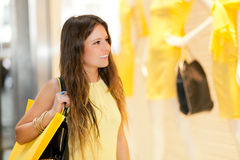Smiling young woman shopping in the city Stock Images