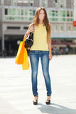 Smiling young woman shopping in the city Royalty Free Stock Images