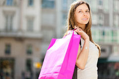 Smiling young woman shopping in the city Royalty Free Stock Image