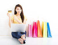 Smiling  young woman shopping with credit card. Smiling  young asian woman shopping with credit card Stock Photography