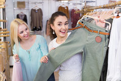 Smiling young woman shopping jersey Stock Image