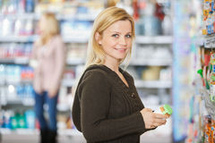 Smiling Young Woman Shopping At Supermarket Stock Photography