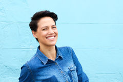 Smiling young woman with short hair and blue shirt Royalty Free Stock Image