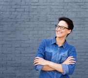 Smiling young woman with short hair and glasses Royalty Free Stock Image