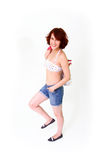 Smiling young woman in shorts Royalty Free Stock Photo