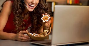 Woman showing christmas cookies while having video Royalty Free Stock Photos