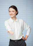 Smiling young woman  showing an empty palm Stock Photo