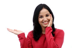 Smiling young woman showing isolated presentation Royalty Free Stock Photography