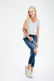Smiling young woman showing ripped pants Royalty Free Stock Photography