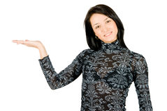 Smiling young woman showing something on her hand Stock Image