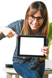 Smiling young woman showing a tablet Stock Image
