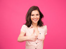 Smiling young woman showing thumb up Stock Photos