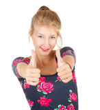 Smiling young woman showing thumbs up Stock Photo