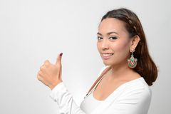 Smiling Young Woman Showing Thumbs Up Stock Photos