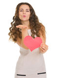 Smiling young woman showing valentines day cards Stock Images