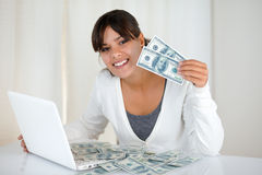Smiling young woman showing you cash money Royalty Free Stock Images