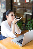 Smiling young woman is sit in a cafe Stock Image