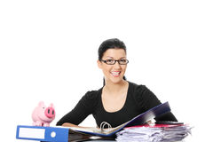 Smiling young woman sitting at the desk Royalty Free Stock Image