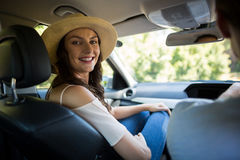 Smiling young woman sitting with man in car Stock Images