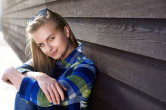 Smiling young woman sitting outside Stock Photos