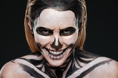 Smiling young woman with skeleton halloween makeup laughing Royalty Free Stock Images