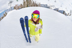 Smiling young woman in ski mask on snow mountains Royalty Free Stock Photos