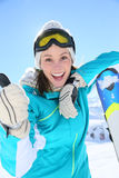 Smiling young woman skier on the slopes Stock Photography