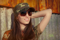 Smiling Young Woman Soldier in Camouflage Outfit Royalty Free Stock Image