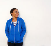 Smiling young woman standing against white background Royalty Free Stock Image