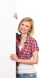 Smiling young woman standing behind placard Royalty Free Stock Photos
