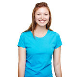 Smiling young woman standing. Blue t-shirt design concept. Portrait of a smiling man in blue t-shirt in a studio over a white background royalty free stock photos