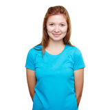 Smiling young woman standing. Blue t-shirt design concept. Portrait of a smiling man in blue t-shirt in a studio over a white background stock photography