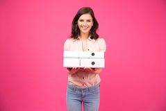 Smiling young woman standing with folders Stock Photos