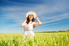 Smiling young woman in straw hat on cereal field Stock Photography